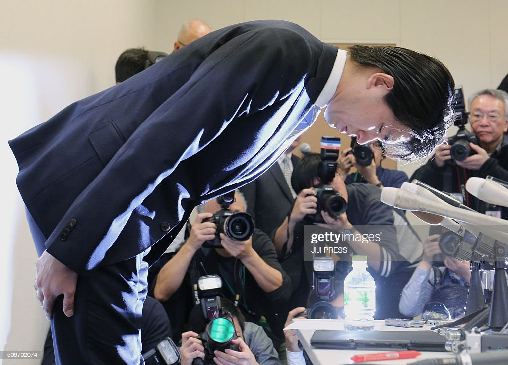 Japan's Liberal Democratic Party (LDP) lawmaker Kensuke Miyazaki bows at a press conference in Tokyo on February 12, 2016. A Japanese politician who made headlines over his quest to take paternity leave quit on February 12 after admitting to an affair with a bikini model while his wife was pregnant. JAPAN OUT AFP PHOTO / JIJI PRESS / AFP / JIJI PRESS / JIJI PRESS