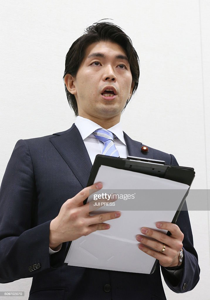 Japan's Liberal Democratic Party (LDP) lawmaker Kensuke Miyazaki speaks at a press conference in Tokyo on February 12, 2016. A Japanese politician who made headlines over his quest to take paternity leave quit on February 12 after admitting to an affair with a bikini model while his wife was pregnant. JAPAN OUT AFP PHOTO / JIJI PRESS / AFP / JIJI PRESS / JIJI PRESS