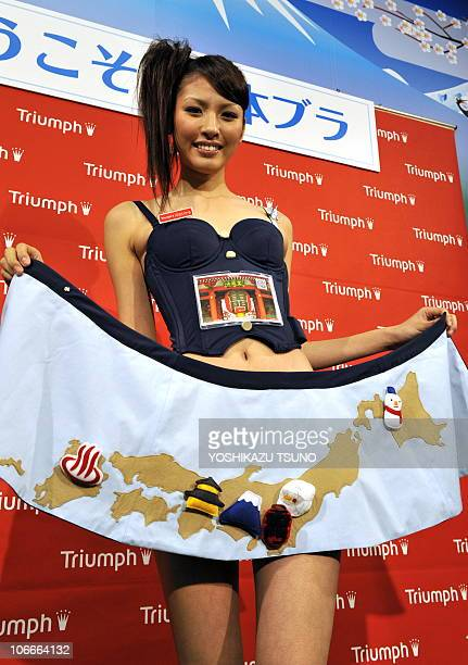 Japan's lingerie maker Triumph International Japan campaign girl Hikaru Kawai displays Japan's tourism promotion bra 'Welcome to Japan Bra' in Tokyo...