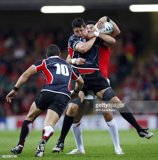 Japan's lock Luke Thompson vies with Wales' scrumhalf Michael Phillips during their rugby union World Cup group B match Wales vs Japan 20 September...