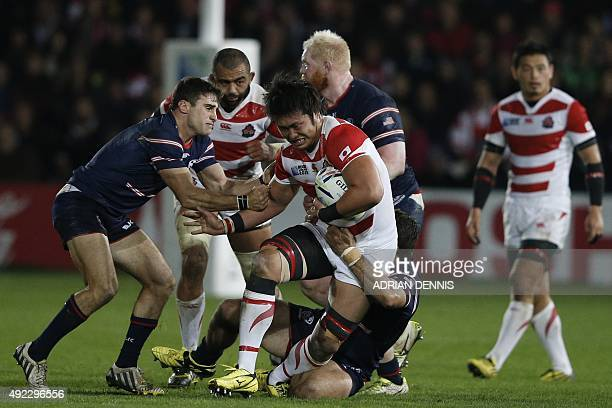 Japan's lock Shinya Makabe is tackled during the Pool B match of the 2015 Rugby World Cup between USA and Japan at Kingsholm stadium in Gloucester...