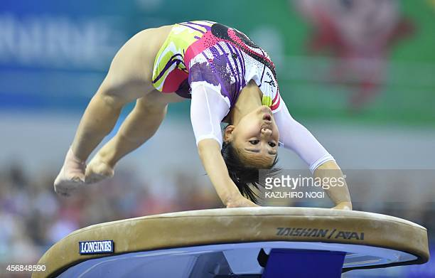 Japan's Mai Murakami performs on the vault during the women's team final of the Gymnastics World Championships in Nanning in China's southern Guangxi...