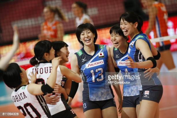 Japan's Mai Okumura and Risa Shinnabe celebrate with teammates during a match against the Netherlands at the Women Volleyball World Grand Prix in...