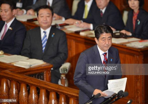 Japan's main opposition Liberal Democratic Party president Shinzo Abe takes the platform to question on Prime Minister Yoshihiko Noda's policy speech...