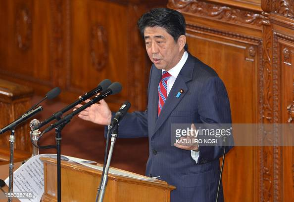 Japan's main opposition Liberal Democratic Party president Shinzo Abe questions Prime Minister Yoshihiko Noda's policy speech on the first day of the...