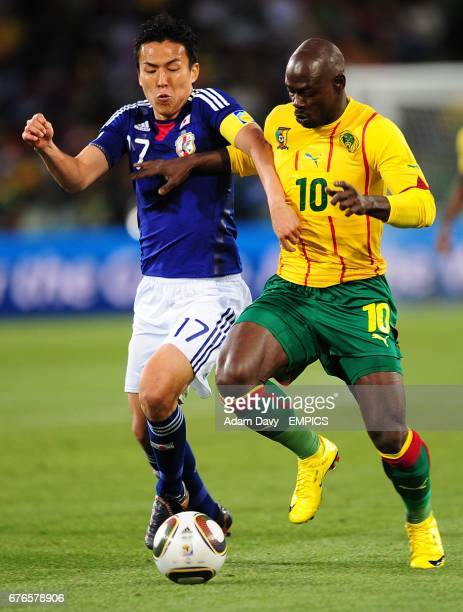 Japan's Makoto Hasebe and Cameroon's Achille Emana battle for the ball