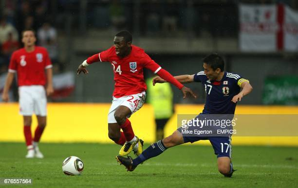 Japan's Makoto Hasebe and England's Shaun WrightPhillips battle for the ball