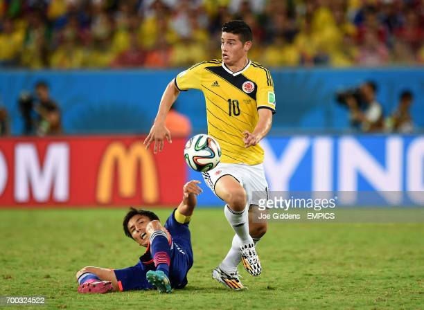 Japan's Makoto Hasebe battles for the ball with Colombia's James Rodriguez