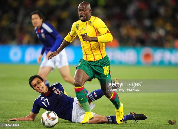 Japan's Makoto Hasebe challenges Cameroon's Achille Emana for the ball