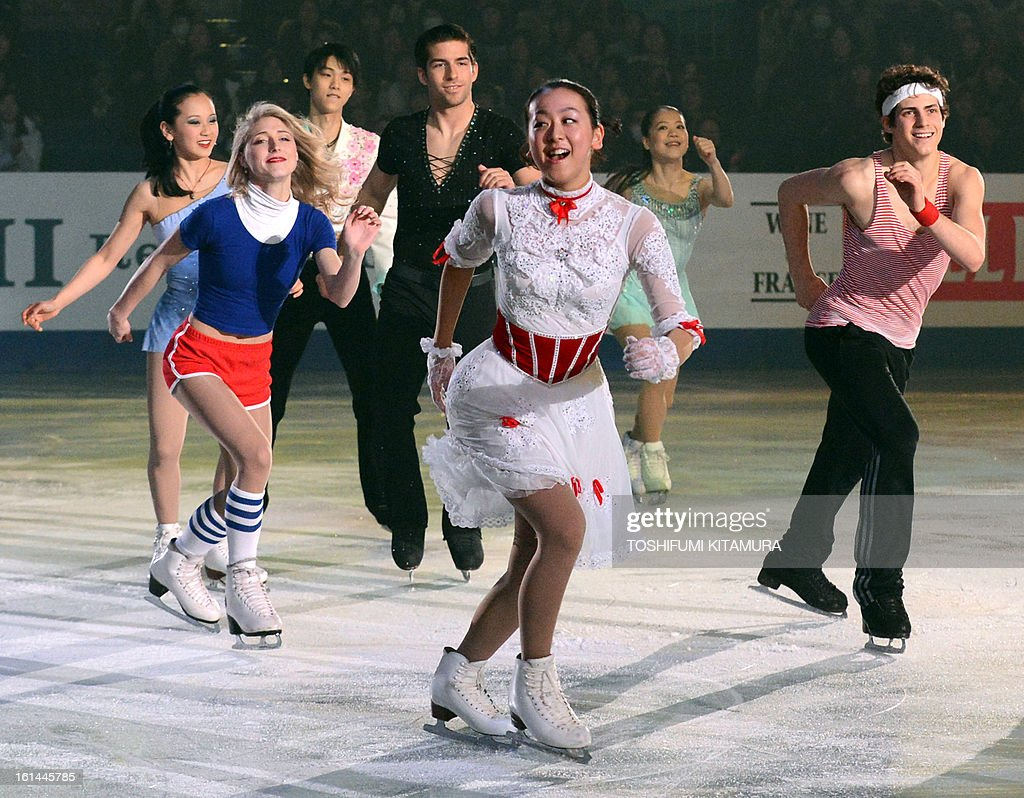 Japan's Mao Asada (C) dances with other skaters during the gala exhibition event after the Four Continents figure skating championships in Osaka on February 11, 2013.