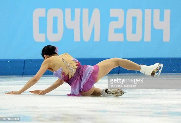 Japan's Mao Asada falls as she performs in the Women's Figure Skating Team Short Program at the Iceberg Skating Palace during the 2014 Sochi Winter...