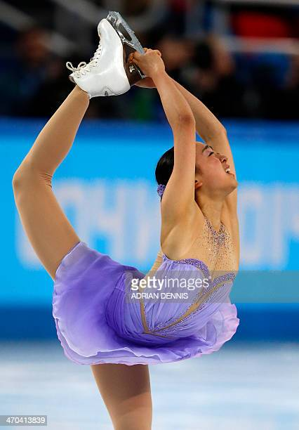 Japan's Mao Asada performs in the Women's Figure Skating Short Program at the Iceberg Skating Palace during the Sochi Winter Olympics on February 19...