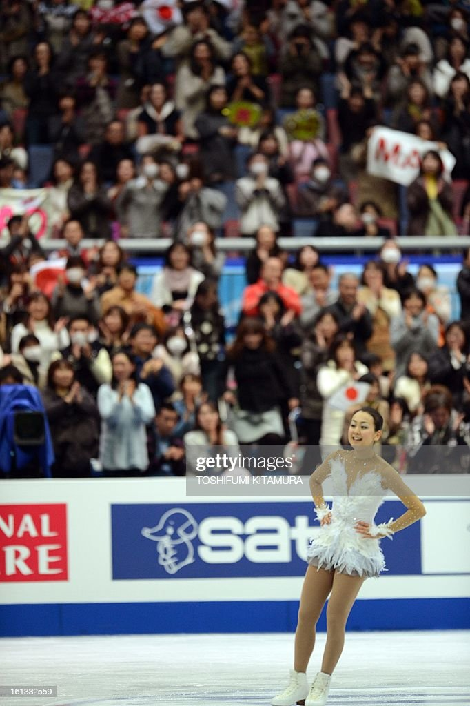 Japan's Mao Asada (R) receives cheers after her free skating performance in the ladies free skating event at the Four Continents figure skating championships in Osaka, February 10, 2013. AFP PHOTO / TOSHIFUMI KITAMURA