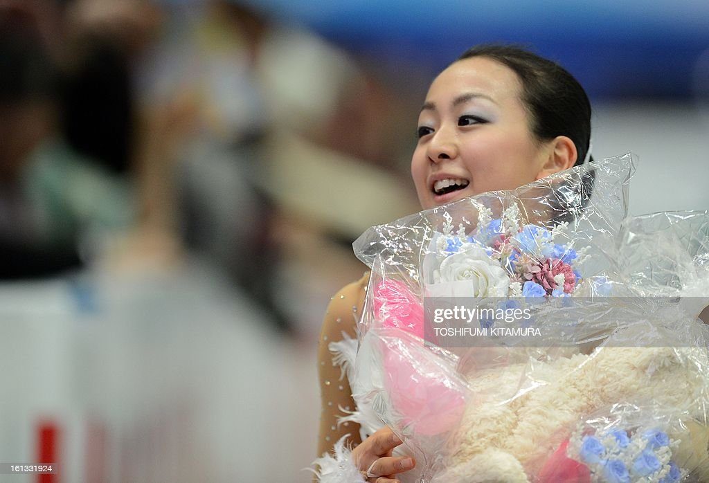 Japan's Mao Asada smiles after her free skating performance in the ladies free skating event at the Four Continents figure skating championships in Osaka, February 10, 2013.