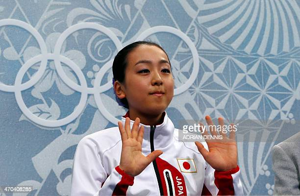Japan's Mao Asada waits for her marks in the Kiss and Cry zone after performing in the Women's Figure Skating Short Program at the Iceberg Skating...