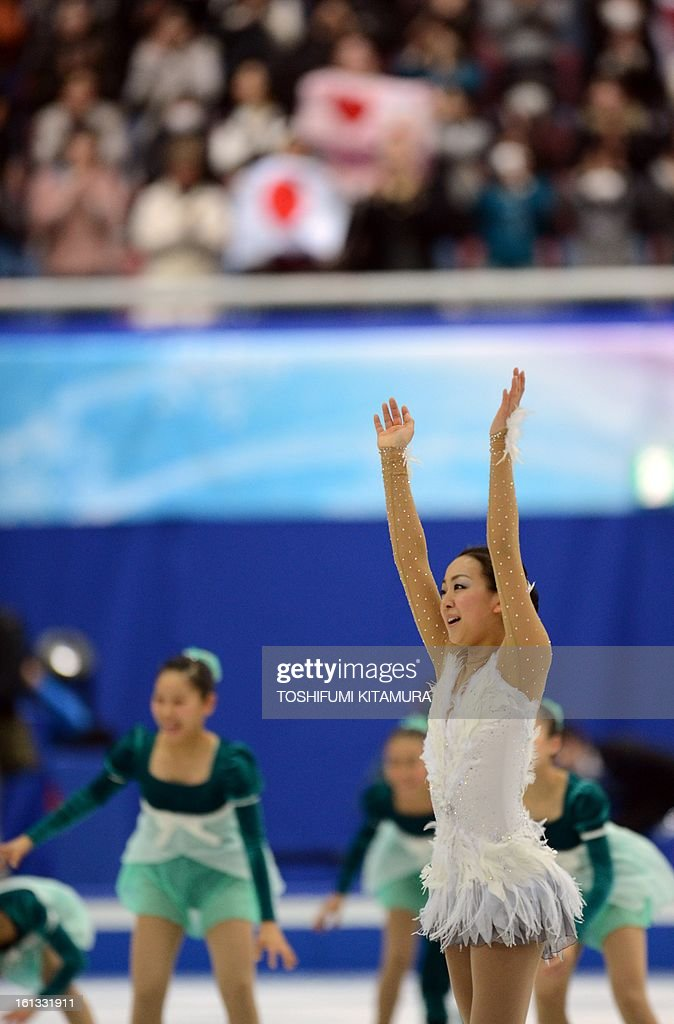 Japan's Mao Asada waves after her free skating performance in the ladies free skating event at the Four Continents figure skating championships in Osaka, February 10, 2013.