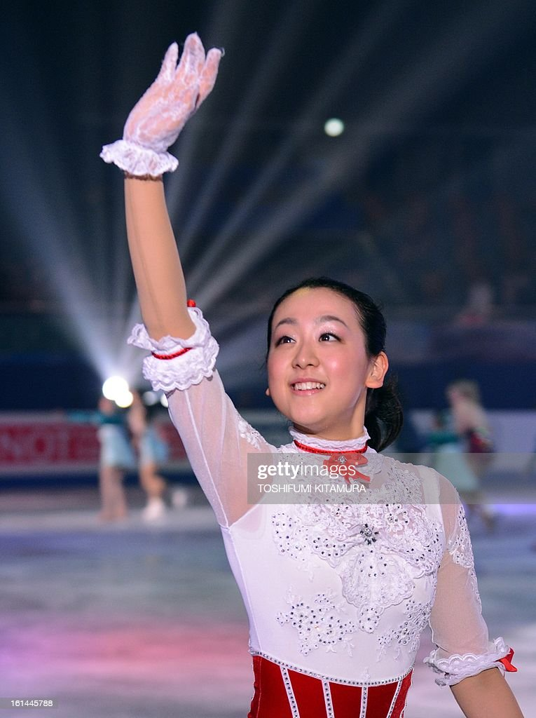 Japan's Mao Asada waves to spectators during the gala exhibition eventafter the Four Continents figure skating championships in Osaka on February 11, 2013.
