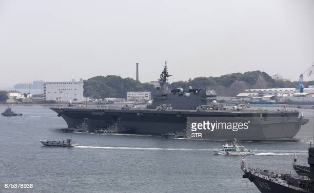 Japan's Maritime Self Defense Forces helicopter carrier Izumo sails out its Yokosuka Base in Kanagawa prefecture on May 1 2017 Japan on May 1...