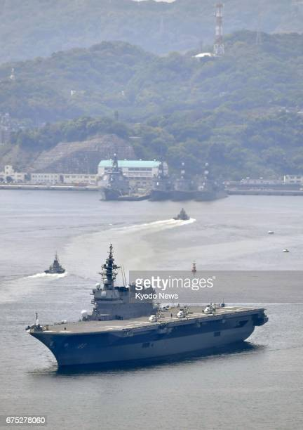 Japan's Maritime SelfDefense Force helicopter carrier Izumo leaves Yokosuka base in Kanagawa Prefecture southwest of Tokyo on May 1 as seen in this...