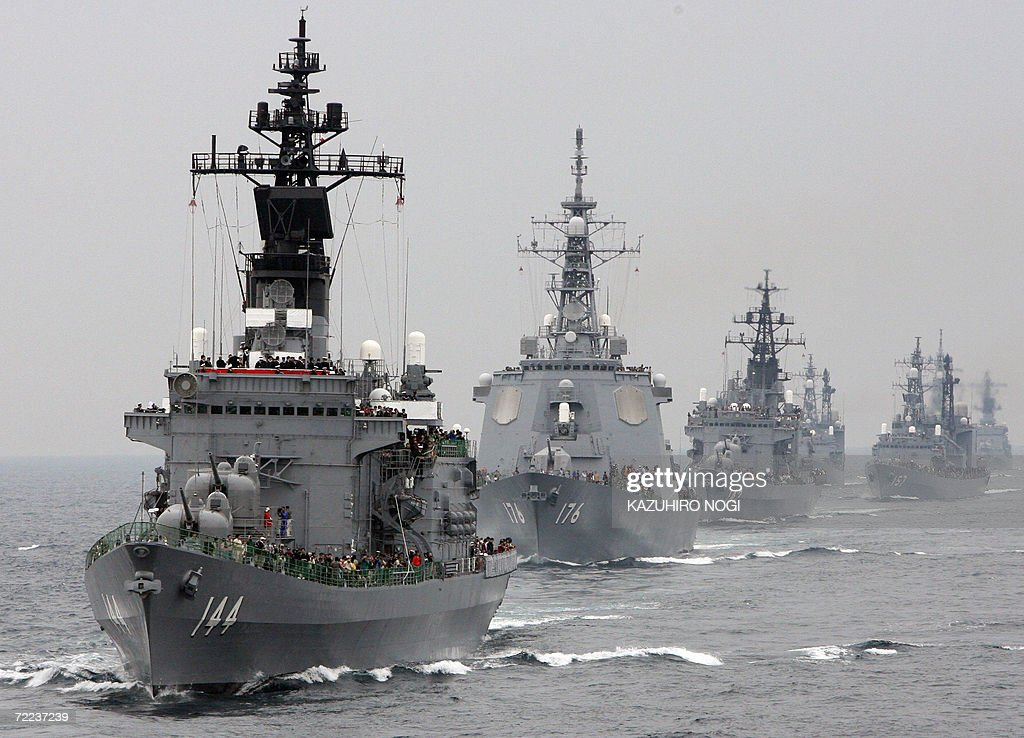 Japan's Maritime SelfDefense Force ship Kurama leads other ships during its fleet review exercise off Sagami Bay south of Tokyo 22 October 2006 The...