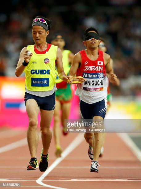 Japan's Masahiro Taniguchi and guide Shogo Matsugaki in the the Men's 5000m T11 Final during day two of the 2017 World Para Athletics Championships...