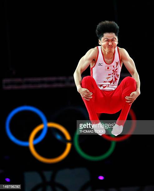 Japan's Masaki Ito grimaces as he competes in the men's trampoline final of the artistic gymnastics event of the London 2012 Olympic Games in London...