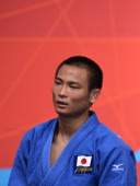 Japan's Masashi Ebinuma leaves after losing against Georgia's Lasha Shavdatuashvili during their men's 66kg contest semifinal match of the judo event...