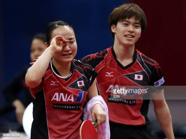 Japan's Masataka Morizono and Mima Ito react after their mixed doubles semifinal against China's Fang Bo and Wang Manyu at the Asian Table Tennis...