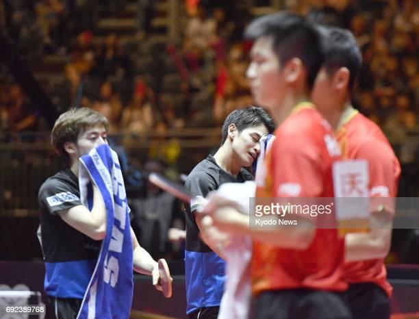 Japan's Masataka Morizono and Yuya Oshima react after losing to China's Fan Zhendong and Xu Xin in the men's doubles final of the world table tennis...
