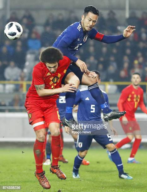 Japan's Maya Yoshida and Belgium's Axel Witsel vie for the ball during the second half of a soccer friendly in Bruges Belgium on Nov 14 2017 Belgium...