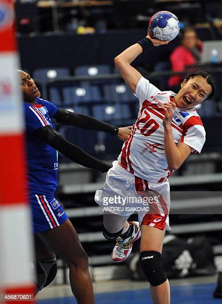 Japan's Mayuko Ishitate vies with France's Paule Baudouin during the Women's 2013 Handball World Championships match France vs Japan on December 15...