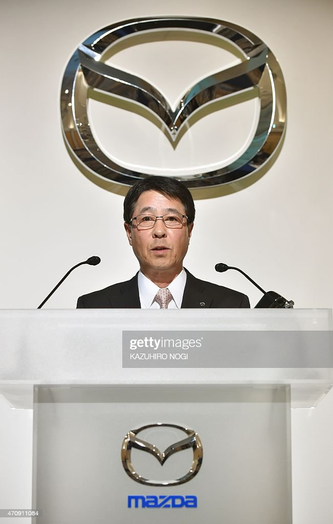 Japan's Mazda Motor Corporation President and Chief Executive Officer <a gi-track='captionPersonalityLinkClicked' href=/galleries/search?phrase=Masamichi+Kogai&family=editorial&specificpeople=10904432 ng-click='$event.stopPropagation()'>Masamichi Kogai</a> answers questions during a press conference to announce their financial results for the company's fiscal year ending March 2015 financial results in Tokyo on April 24, 2015. Global sales volume was 1,397,000 units, up 5% from the prior year, Mazda said.