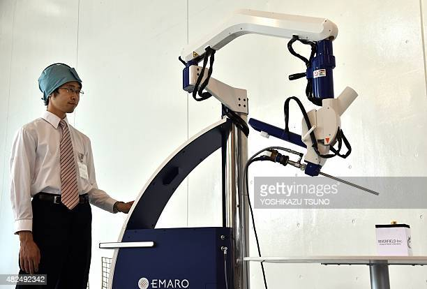 Japan's medical machine venture Riverfield engineer demonstrates the world's first pneumatically controlled endoscope robot 'Emaro' to assist low...