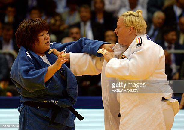 Japan's Megumi Tachimoto competes with Germany's Jasmin Kuelbs during the 78kg category competition at the World Judo Championships in Chelyabinsk on...