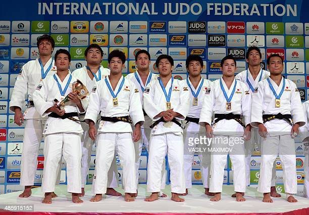 Japan's men judo team poses with their gold medals following the men's team competition at the Judo World Championships in Astana on August 30 2015...