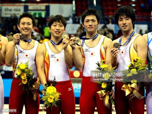 Japan's Men's Team of Takashi Sakamoto Tetsuya Sotomura Yasuhiro Ueyama and Masaki Ito celebrate their victory in the Individual Trampoline Man Team...