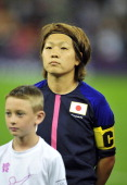 Japan's midfielder Aya Miyama poses before the start of The London 2012 Olympic Games women's quarterfinal football match between Brazil and Japan at...