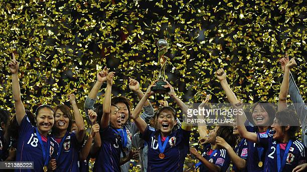 Japan's midfielder Homare Sawa celebrates with the trophy and teammates after the FIFA Women's Football World Cup final match Japan vs USA on July 17...