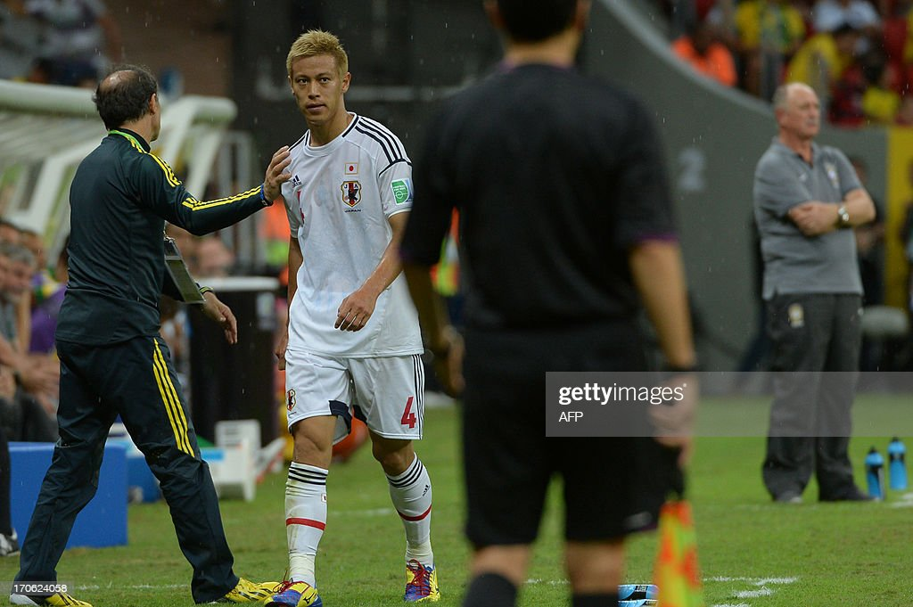 Japan's midfielder Keisuke Honda leaves the field after beig replaced by teammate Takashi Inui during the FIFA Confederations Cup Brazil 2013 Group A football match against Brazil, at the National Stadium in Brasilia on June 15, 2013.
