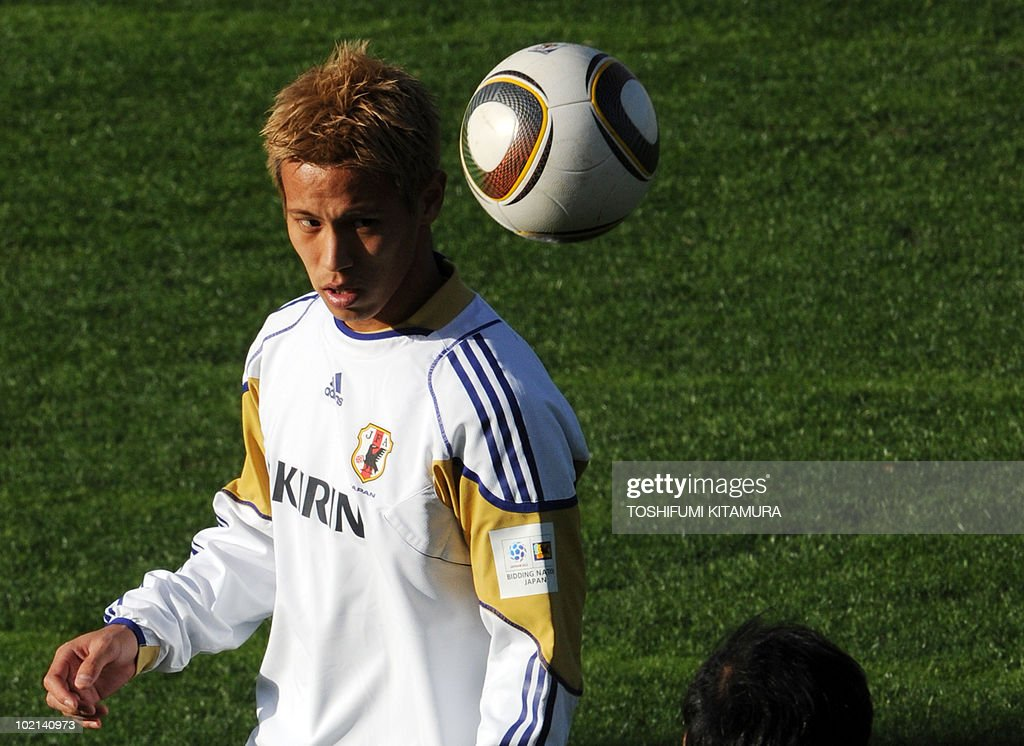 Japan's midfielder Keisuke Honda looks at the ball during their training session in George, on June 16, 2010. Japan beat Cameroon in their first match and faces the Netherlands in Durban on June 19.