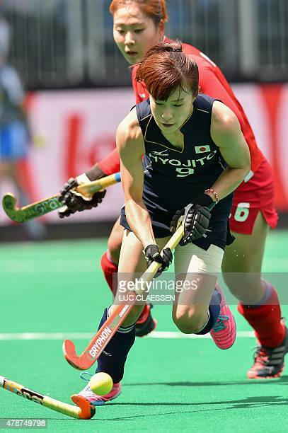 Japan's Mie Nakashima controls the ball during the women's Group A stage match between Japan and South Korea at the World League field hockey...