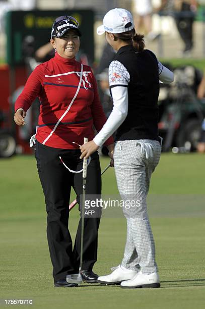 Japan's Miki Saiki embraces Korea's Choi Na Yeon after their final rounds in the Women's British Open Golf Championship at the Old Course in St...