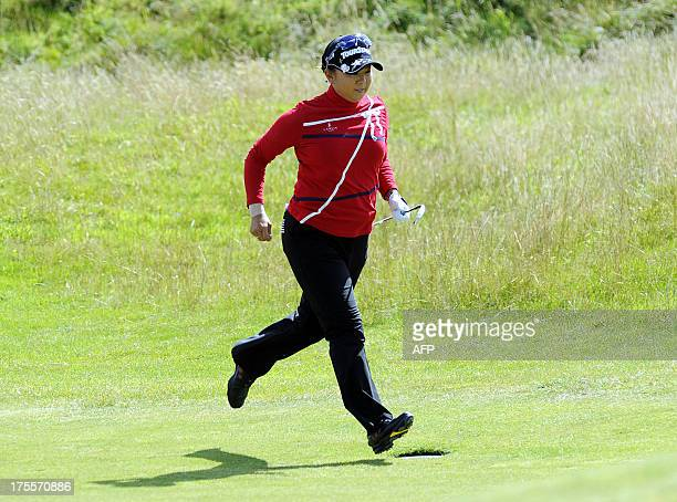 Japan's Miki Saiki runs up the 5th fairway during her final round in the Women's British Open Golf Championship at the Old Course in St Andrews...
