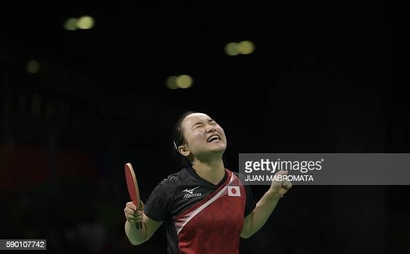 TOPSHOT Japan's Mima Ito celebrates winning the women's team bronze medal table tennis match against Singapore at the Riocentro venue during the Rio...