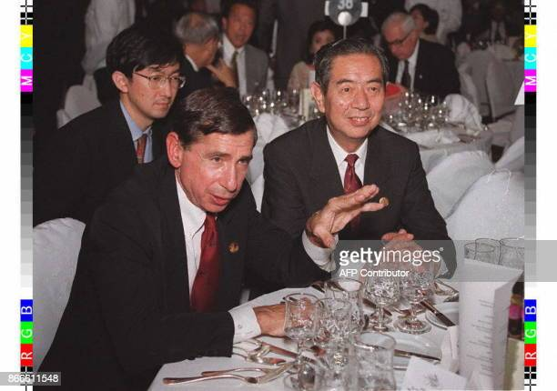 Japan's minister for foreign affairs Yukihiko Ikeda looks on as US Secretary of Commerce Mickey Kantor gestures during a dinner 23 November prior to...