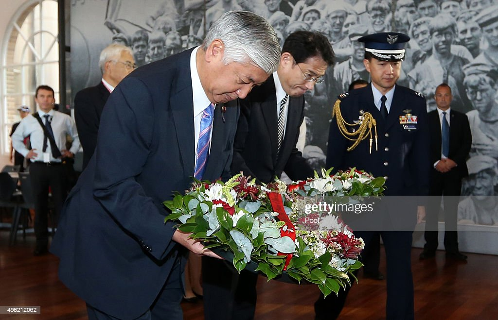 Japan's Minister of Defense <a gi-track='captionPersonalityLinkClicked' href=/galleries/search?phrase=Gen+Nakatani&family=editorial&specificpeople=2676983 ng-click='$event.stopPropagation()'>Gen Nakatani</a> (C) and Minister for Foreign Affairs, <a gi-track='captionPersonalityLinkClicked' href=/galleries/search?phrase=Fumio+Kishida&family=editorial&specificpeople=10093794 ng-click='$event.stopPropagation()'>Fumio Kishida</a>, pay their respects and lay wreaths at a World War 2 Japanese midget submarine display during a visit to the Royal Australian Navy Heritage Centre on November 22, 2015 in Sydney, Australia. The Minister's were accompanied by Australia's Minister for Foreign Affairs Julie Bishop as part of the sixth Australia-Japan Foreign and Defence Ministerial Meeting.