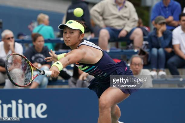 Japan's Misaki Doi returns the ball to Czech Republic's Barbora Strycova during their Qualifying Women's Singles match at the 2017 US Open Tennis...