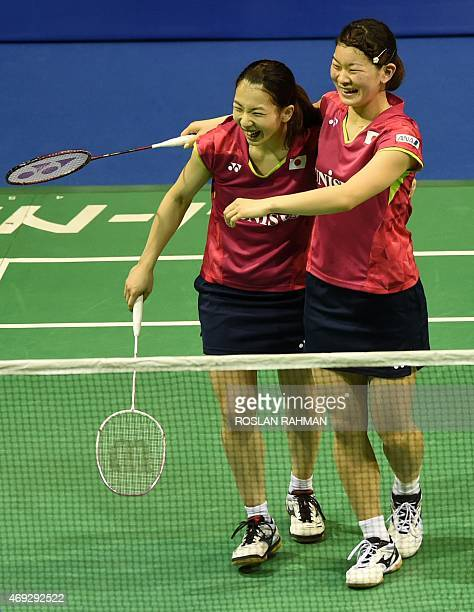 Japan's Misaki Matsutomo and Ayaka Takahashi celebrate after defeating against China's Wang Xiaoli and Yu Tang in their women's double semifinals of...