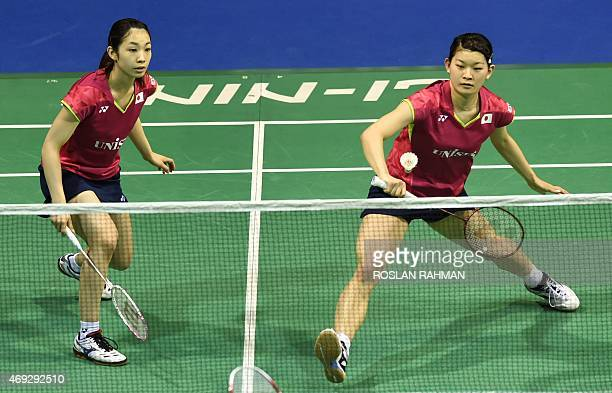Japan's Misaki Matsutomo and Ayaka Takahashi play against China's Wang Xiaoli and Yu Tang in their women's double semifinals of the Singapore Open on...