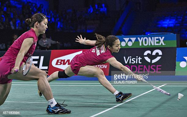 Japan's Misaki Matsutomo and Ayaka Takahashi return to China's Wang Xiaoli and Yu Yang during their women's double final match of the Denmark Open...